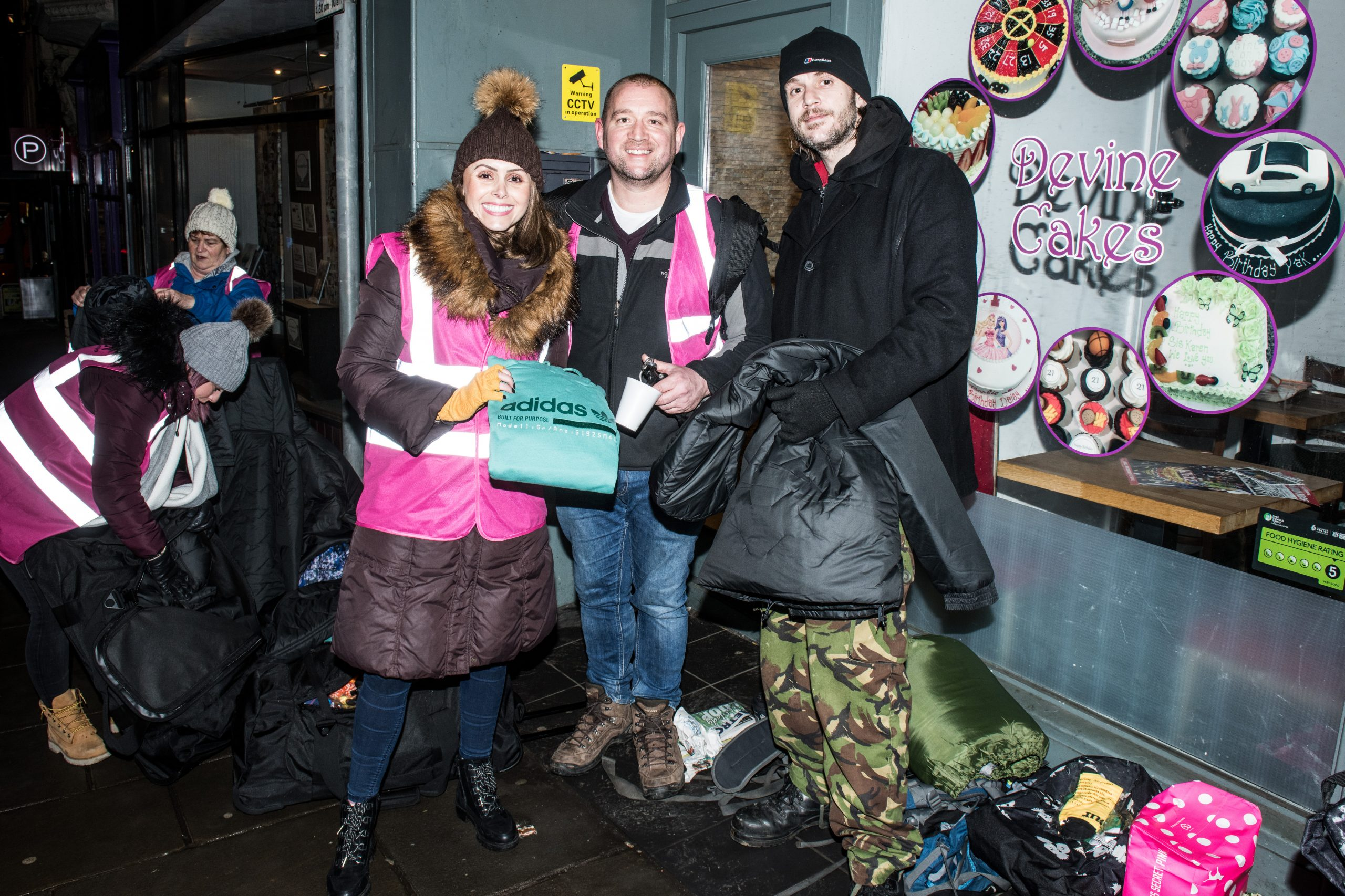 Pass It On volunteers providing used ski gear to homeless people